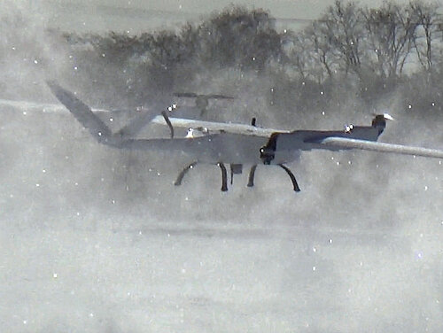 Songbird drone performing a low fly-by in the snow.